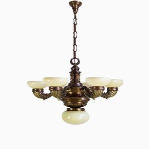 Lámpara de araña antigua de latón y vidrio coloreado
