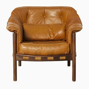 Butaca de cuero marrón claro y palisandro de Arne Norell para Coja, años 60