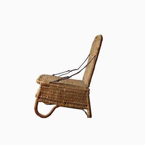 Silla Canoe plegable vintage de cuero y mimbre