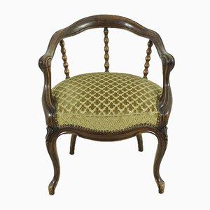 Antiker Armlehnstuhl aus Nussholz