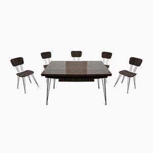 Tavolo da pranzo in acciaio e formica con sedie, anni '60