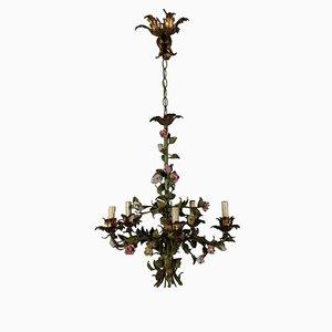 Lámpara de araña antigua de hierro con flores
