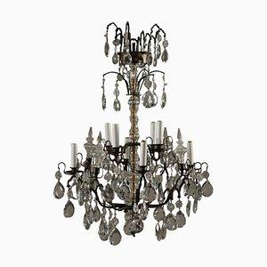 Lámpara de araña antigua de bronce y cristal