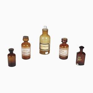 Botellas de farmacia de vidrio ámbar, década de 1870. Juego de 5