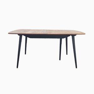 Mesa de comedor extensible Mid-Century con patas negras de Lucian Ercolani para Ercol, años 60