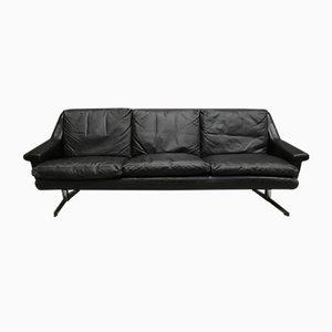 Sofá de tres plazas de cuero negro y cromo, años 50