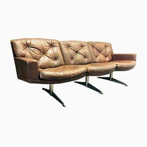 Sofá de tres plazas de cuero y cromo, años 50