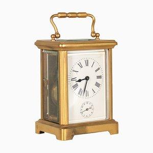 Reloj antiguo de bronce, década de 1890