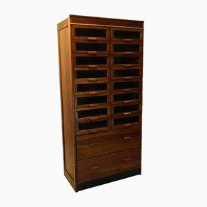 Mueble de mercería inglés de roble con 18 cajones, años 20
