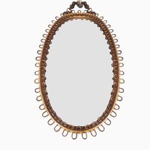 Espejo ovalado con marco de bambú, años 70