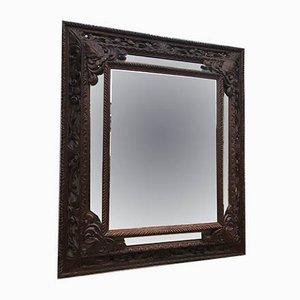 Antiker Spiegel mit Rahmen aus geschnitztem Holz