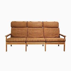 Sofá de tres plazas danés de roble de Illum Wikkelsø, años 60