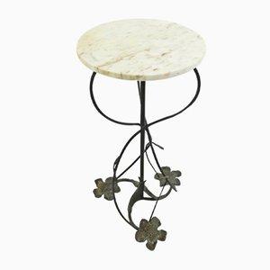 Mesa vintage con pedestal de hierro forjado