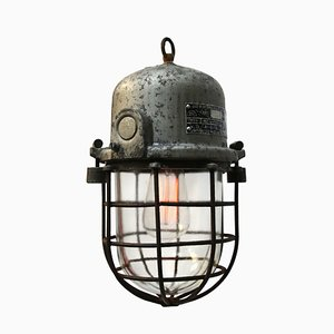 Lámpara industrial vintage de aluminio fundido gris y vidrio transparente, años 50