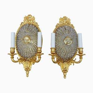 Apliques de pared estilo Louis XVI antiguos ovalados de vidrio y bronce dorado. Juego de 2