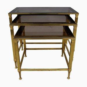 Mesas nido vintage de metal dorado y vidrio ahumado