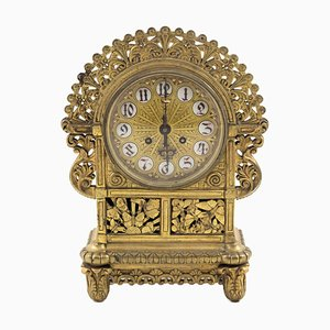 Reloj modernista antiguo de bronce dorado