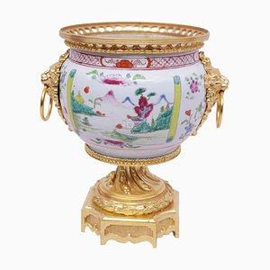 Jarrón antiguo de bronce dorado y porcelana