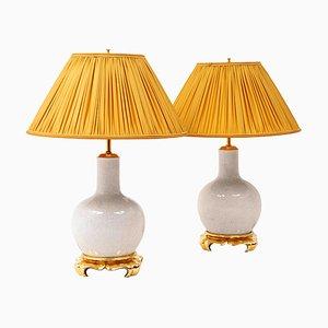 Lámparas de mesa de porcelana y madera dorada, años 70. Juego de 2