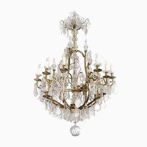 Lámpara de araña estilo Luis XV Mid-Century de latón y cristal de Baccarat, años 50