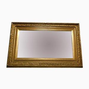 Espejo antiguo dorado con flores talladas