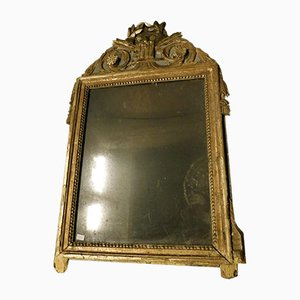 Espejo antiguo de madera dorada