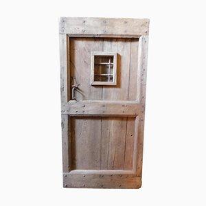 Porta da ingresso antica rustica in castagno con finestra