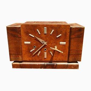 Reloj italiano de nogal con mecanismo de latón y brazos de aluminio, años 30