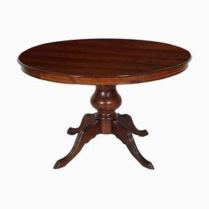 Tavolo rotondo neoclassico in legno di noce intagliato