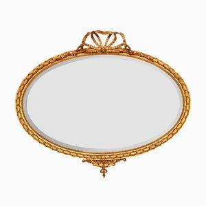 Espejo de pared oval estilo George III antiguo dorado