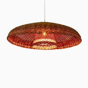 Lámpara colgante italiana de ratán trenzado con reflector, años 60