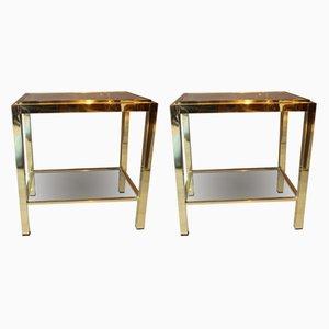 Mesas auxiliares vintage de metal y vidrio, años 70. Juego de 2
