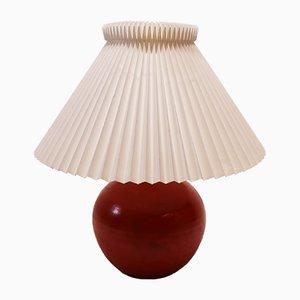Lámpara de mesa de cerámica esmaltada en naranja de Herman A. Kähler, años 50