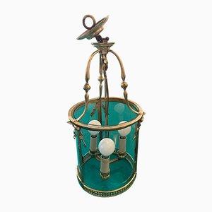 Lámpara de araña Luis XVI antigua de bronce con tres luces