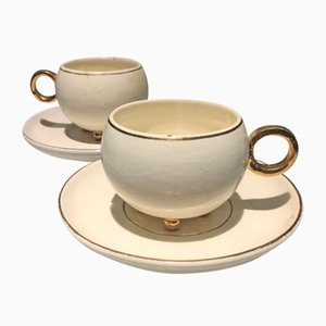 Juego de taza y platillo antiguo con línea dorada de Rudolf Stockar para Artel. Juego de 2