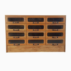 Cassettiera vintage in quercia a 12 cassetti, anni '30