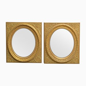 Espejos de pared antiguos de madera dorada. Juego de 2