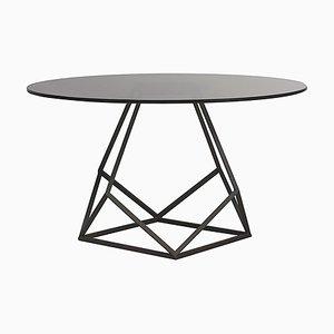 Mesa de comedor de hierro y cristal de Estudihac JMFerrero
