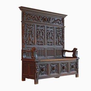 Banco victoriano antiguo de roble tallado