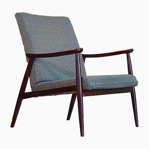 Skandinavischer Mid-Century Armlehnstuhl aus Nussholz, 1960er