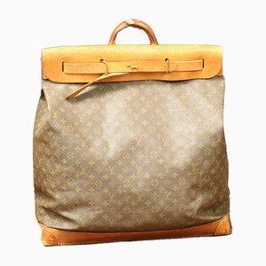 Bolso de viaje vintage de cuero y lona de Louis Vuitton, años 20