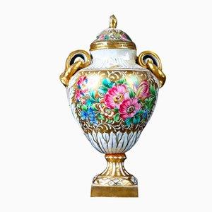 Ánfora antigua floral de porcelana