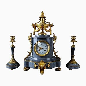 Tris consisting of watch and pair of gray marble and gilded bronze candlesticks.], Set of x