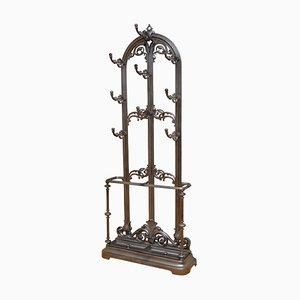 Perchero victoriano antiguo de hierro fundido con ganchos