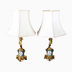 Lámparas francesas ilustradas de bronce y porcelana de Sevres. Juego de 2