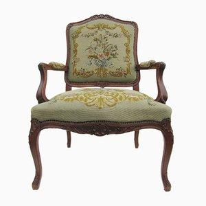 Antiker Louis XV Sessel mit Gestell aus geschnitzter Eiche & besticktem Bezug