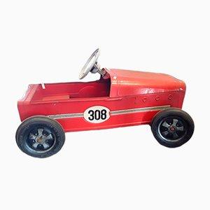 Coche de juguete vintage a pedales de Ferbedo, años 50
