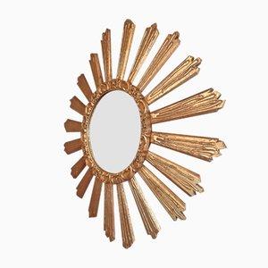 Espejo de pared vintage en forma de sol de madera dorada