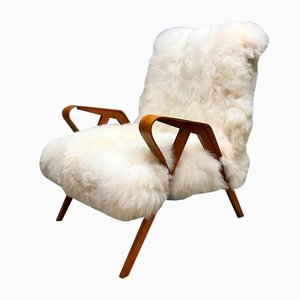 Sheepskin and Wood Armchair from Tatra, 1950s