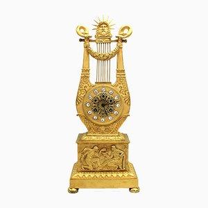 Reloj de péndulo francés estilo imperio antiguo de bronce dorado